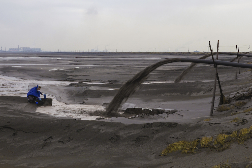 A toxic lake of mine and refinery tailings stretch for over 6km from Baogang Iron and Steel Corporation.